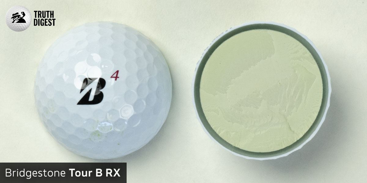 One of the best golf balls cut in half with a core colored green