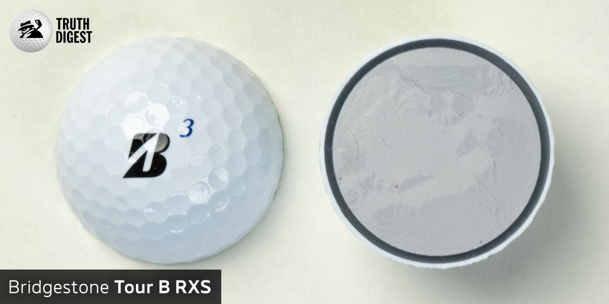 One of the best golf balls cut in half with a core colored grey