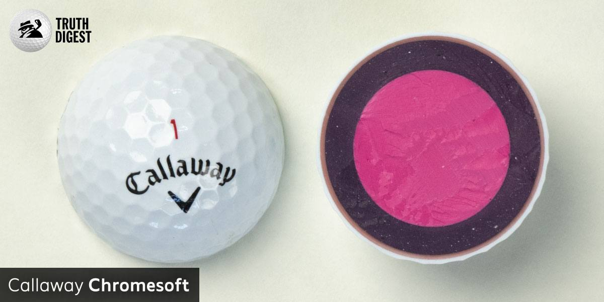 One of the best golf balls cut in half with a core colored pink and dark pink