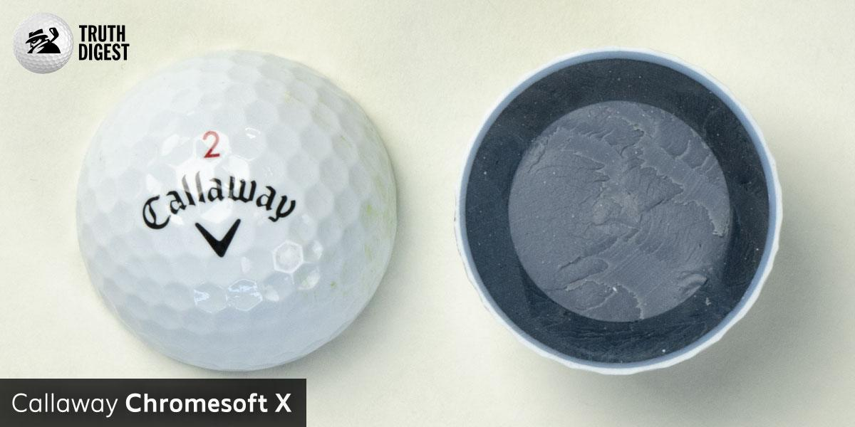 One of the best golf balls cut in half with a core colored grey and dark grey