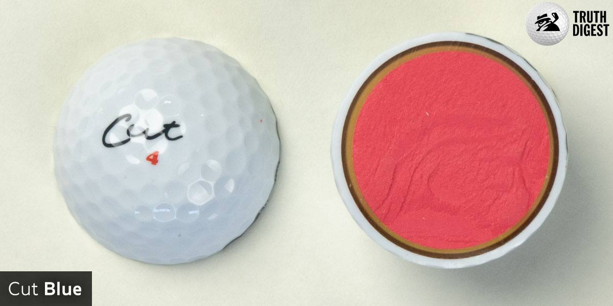 One of the best golf balls cut in half with a core colored orange and black