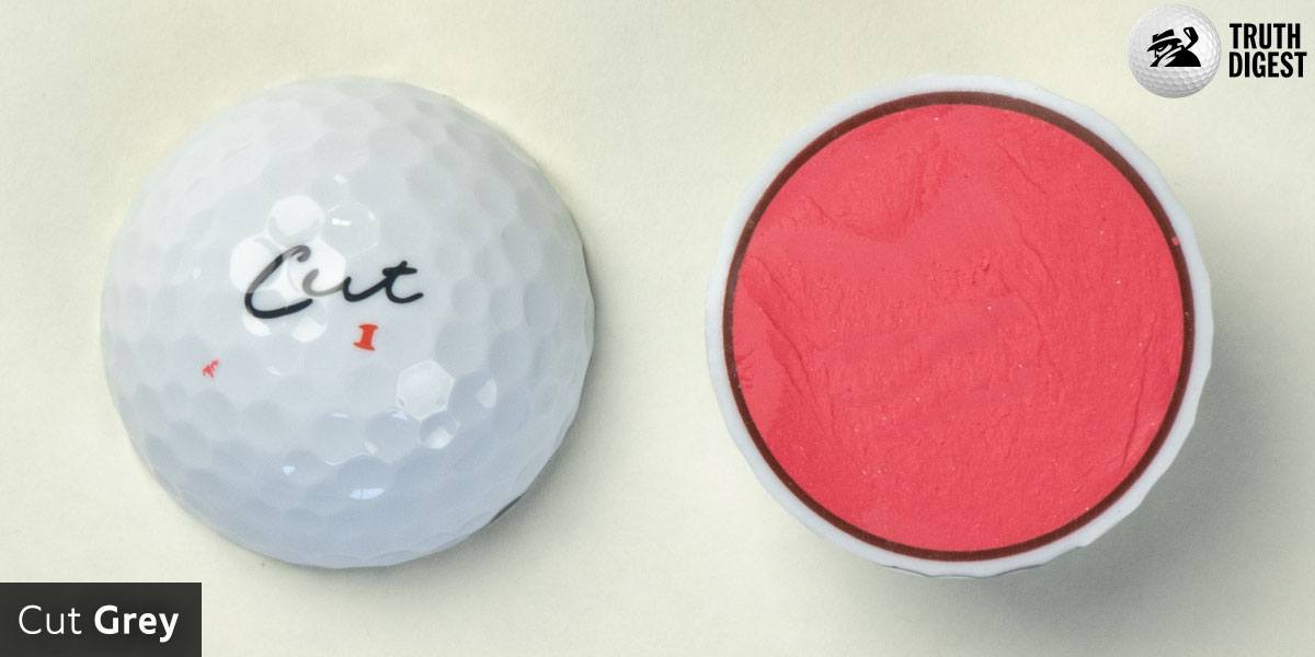 One of the best golf balls cut in half with a core colored salmon