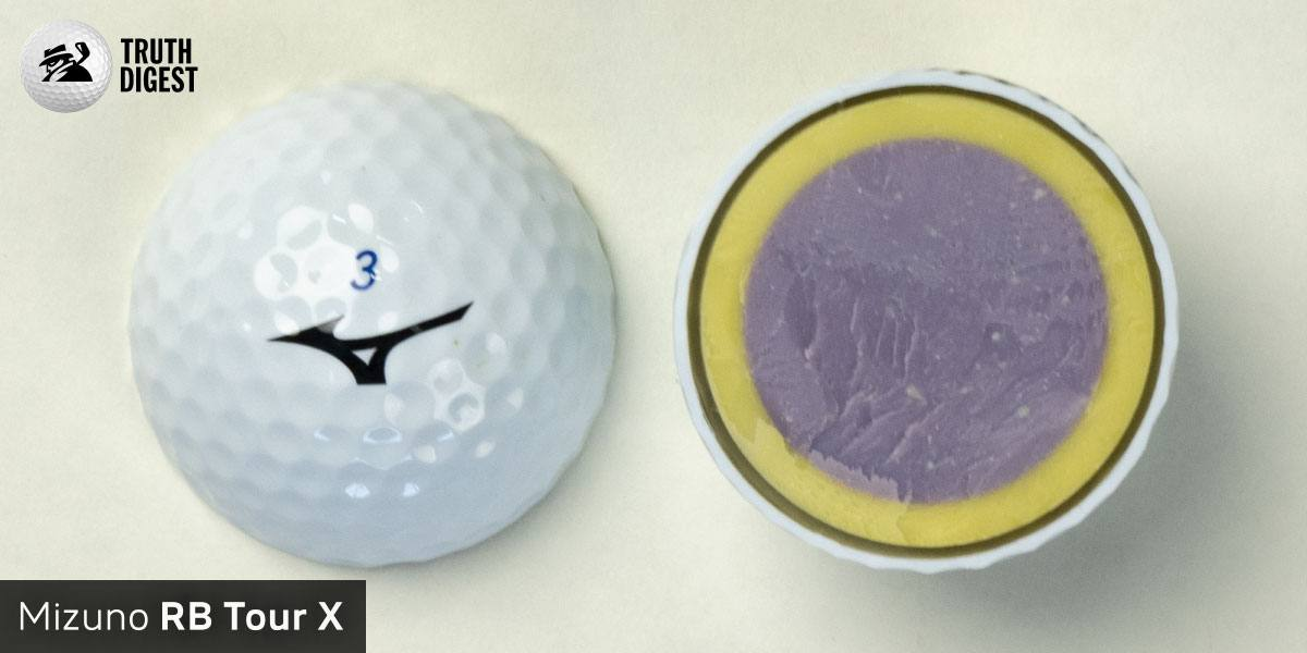 One of the best golf balls cut in half with a core colored purple and yellow