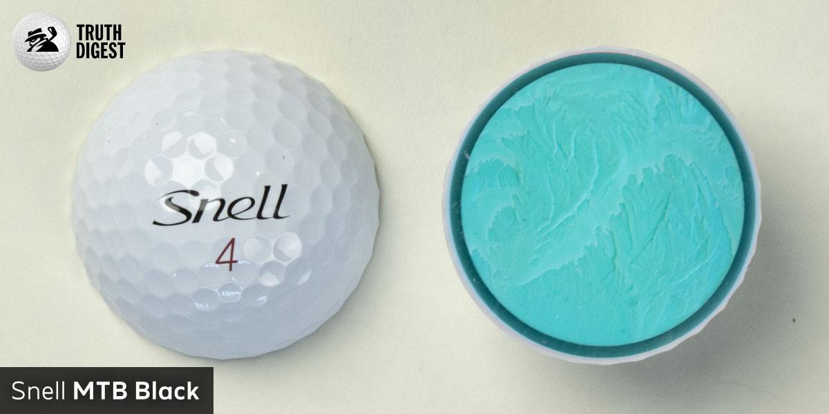 One of the best golf balls cut in half with a core colored bright blue