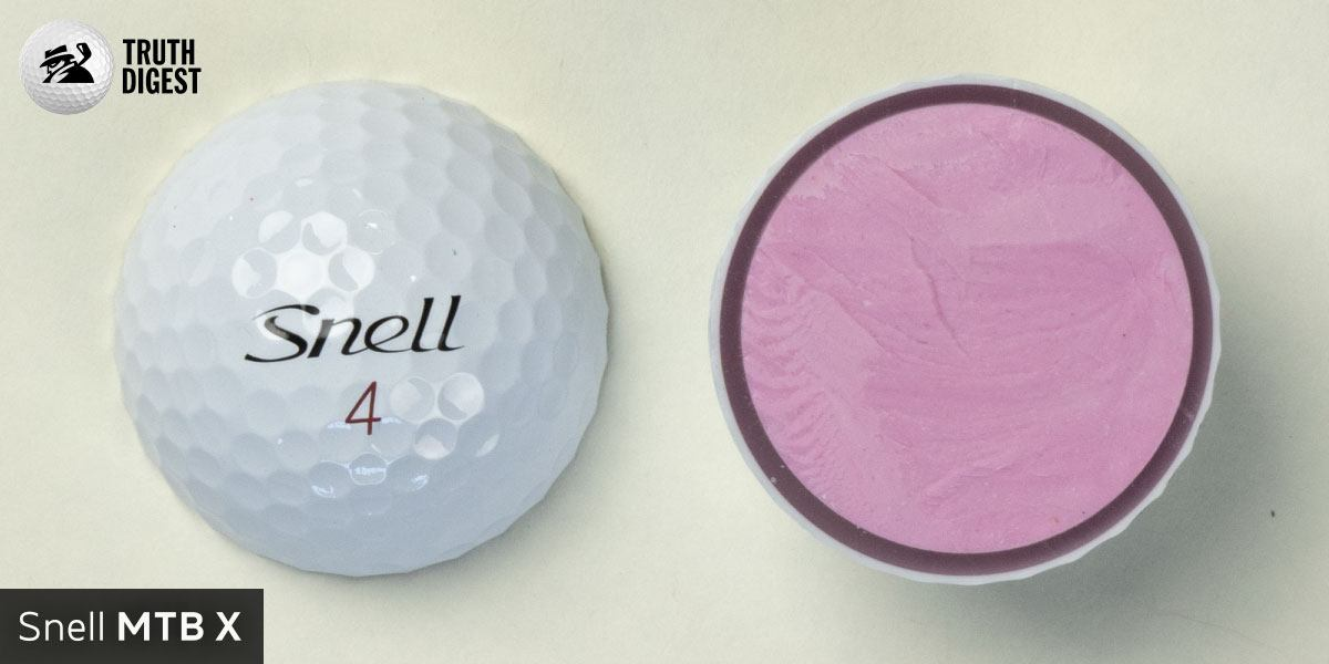 One of the best golf balls cut in half with a core colored soft pink