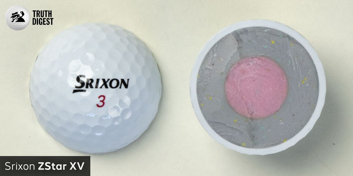 One of the best golf balls cut in half with a core colored pink and grey