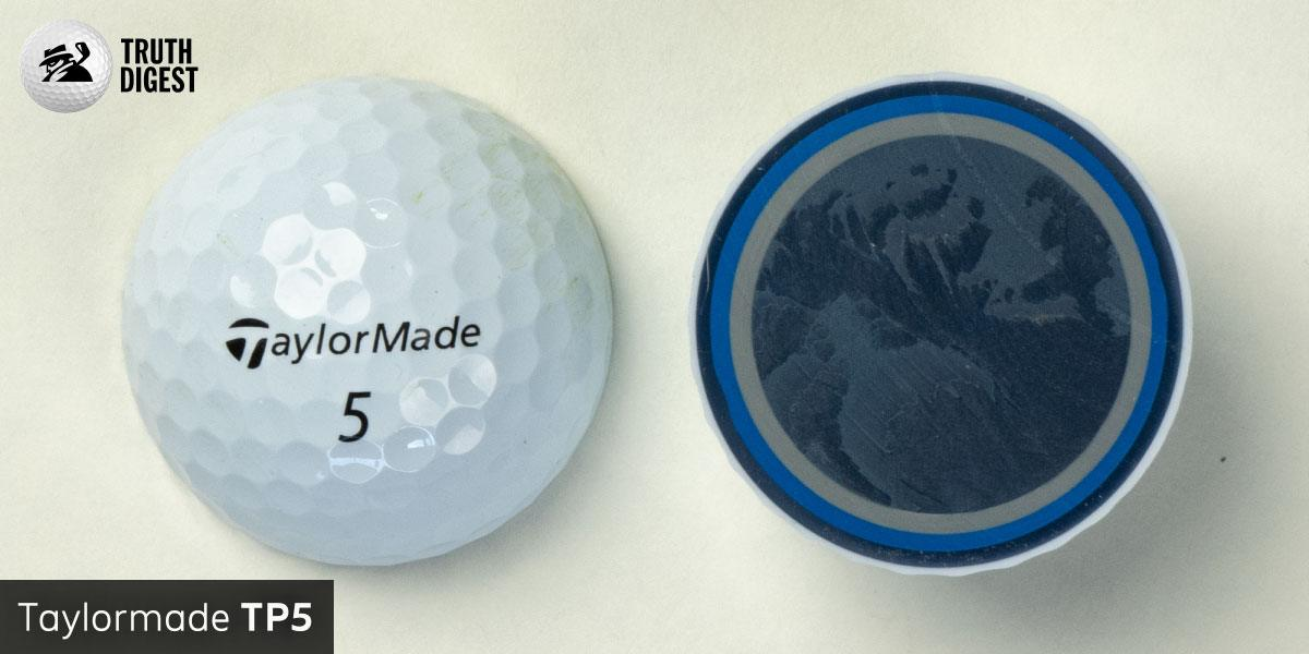 One of the best golf balls cut in half with a core colored black and blue