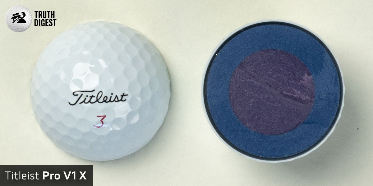 One of the best golf balls cut in half with a core colored purple and blue