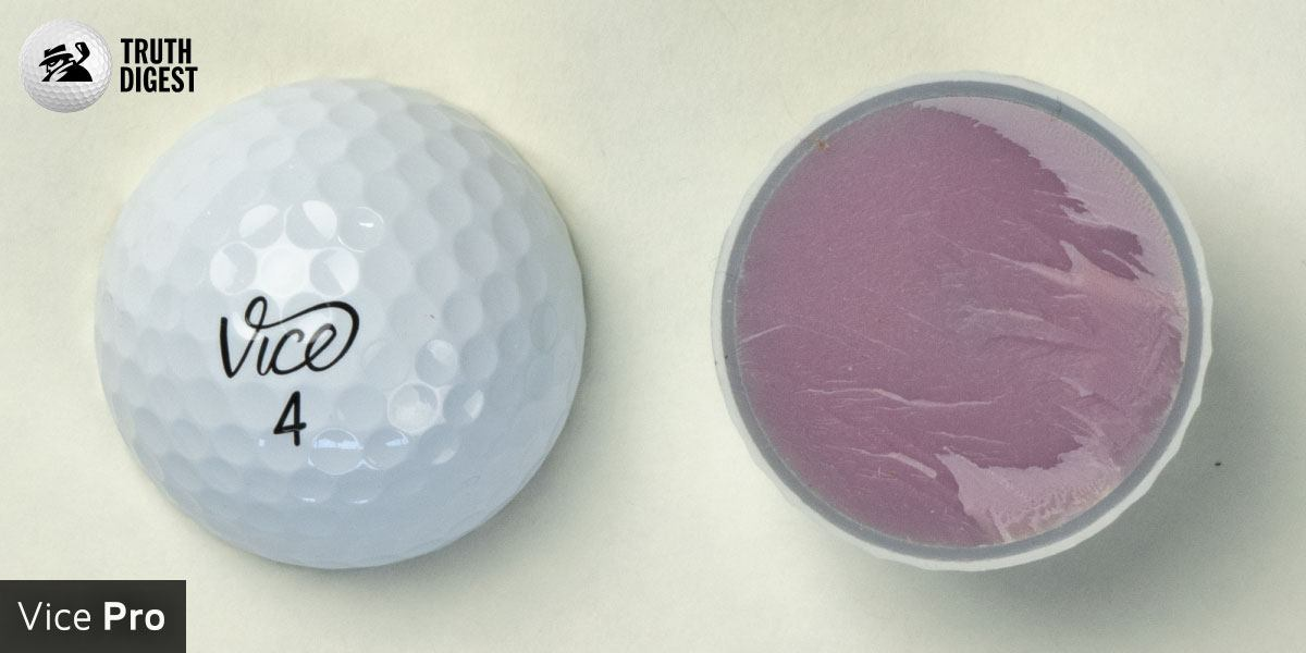 One of the best golf balls cut in half with a core colored light purple