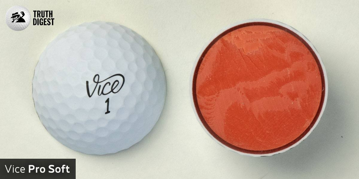 One of the best golf balls cut in half with a core colored orange and red
