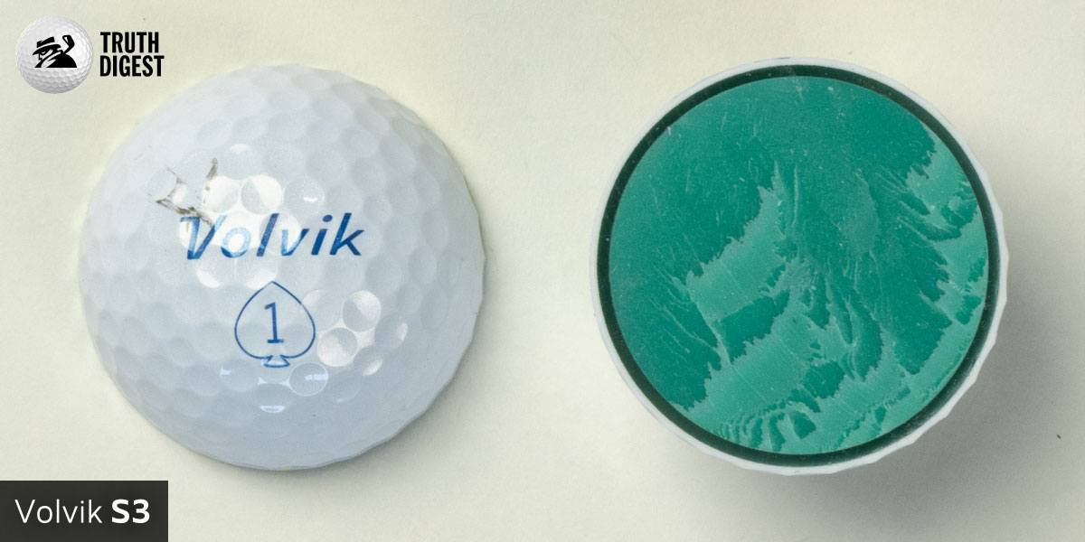 One of the best golf balls cut in half with a core colored blue and red