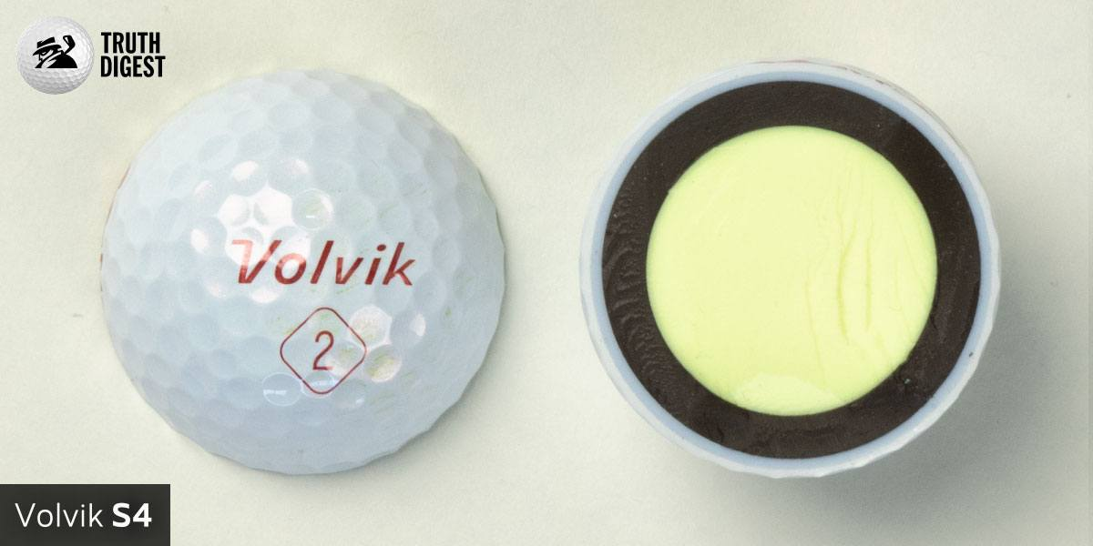 One of the best golf balls cut in half with a core colored cream and black