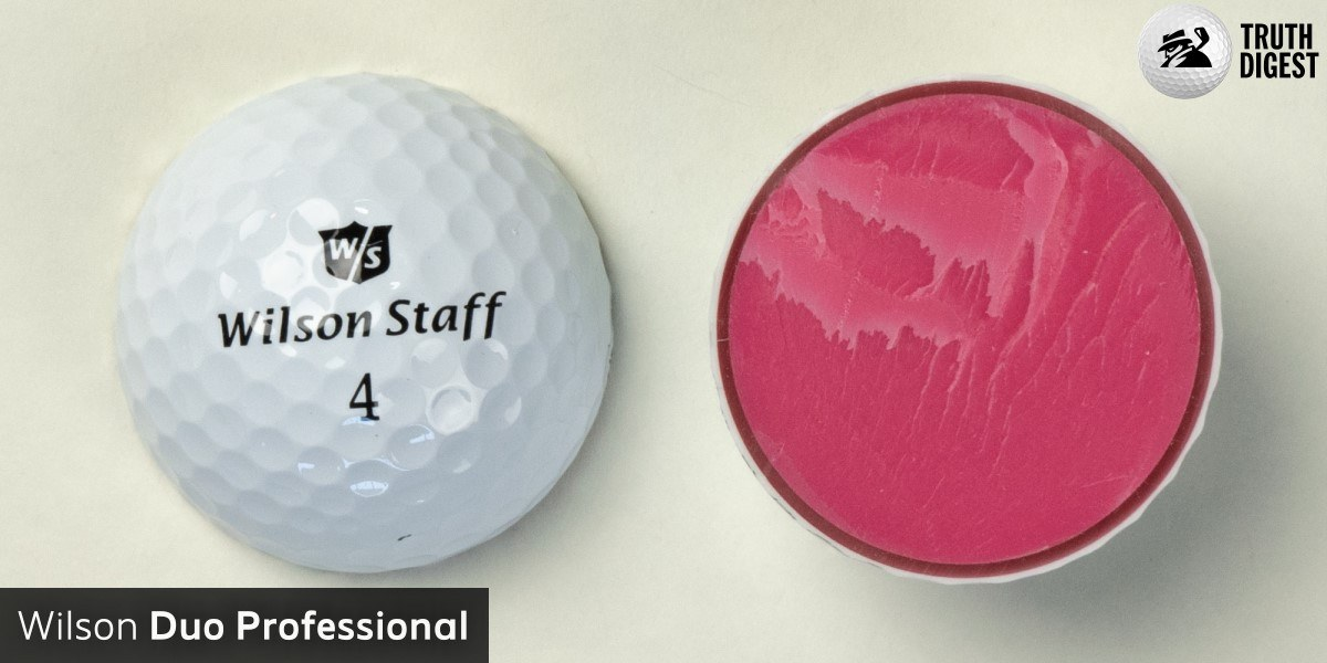 One of the best golf balls cut in half with a core colored salmone