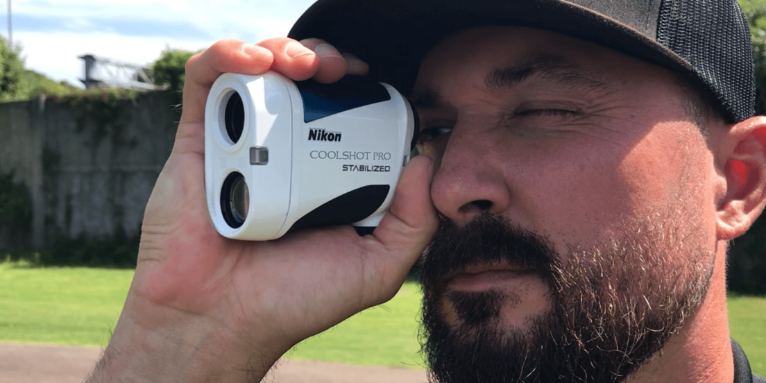 A man looking through a rangefinder rather a GPS