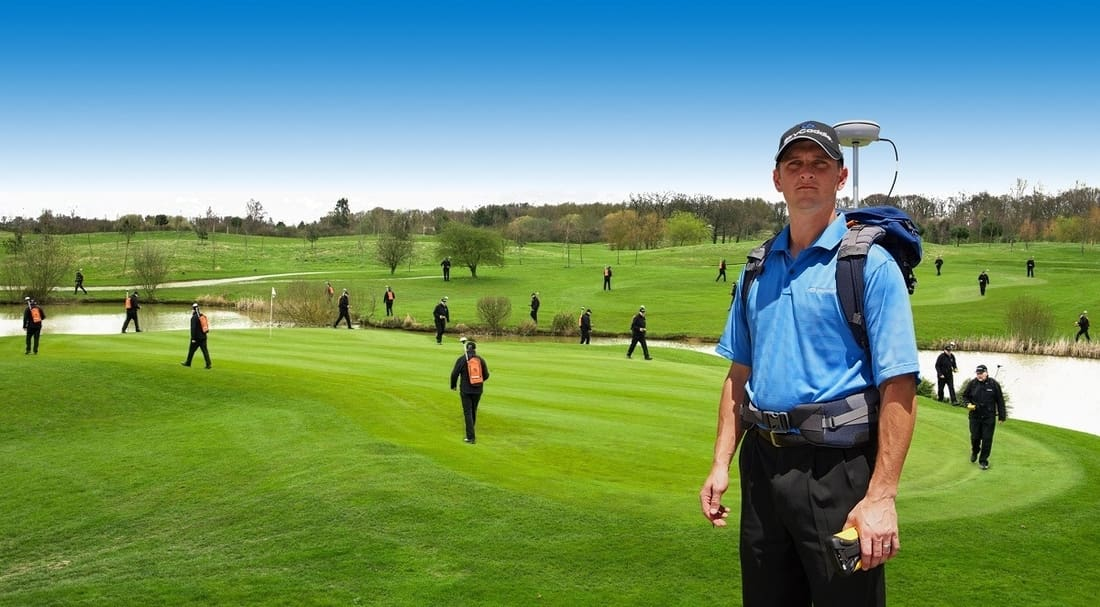A man on a golf course who might need a rangefinder or a GPS