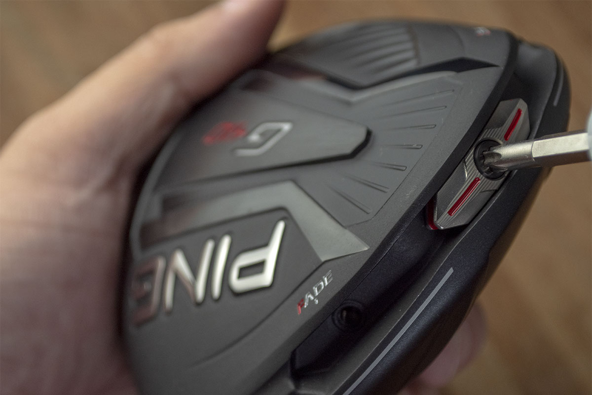 A Ping driver, one of the best 2020 drivers golf, in someone's hand