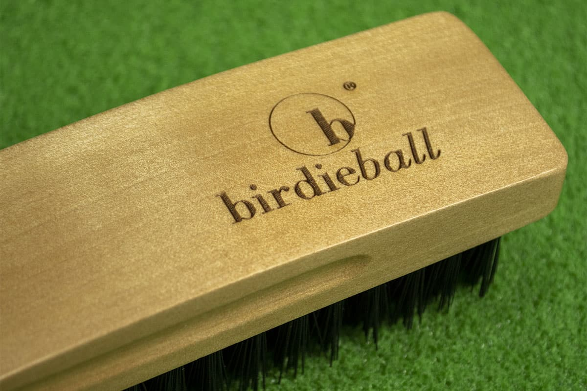 A brush used to brush one of the best indoor putting mats