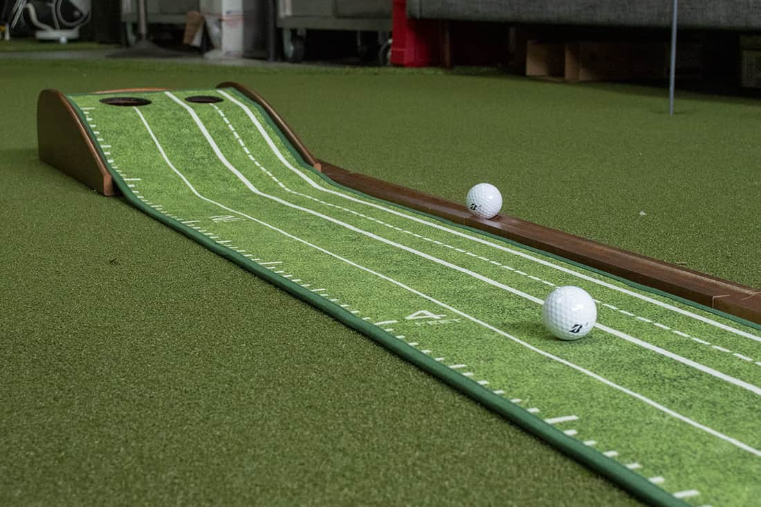 A simple green indoor putting mat