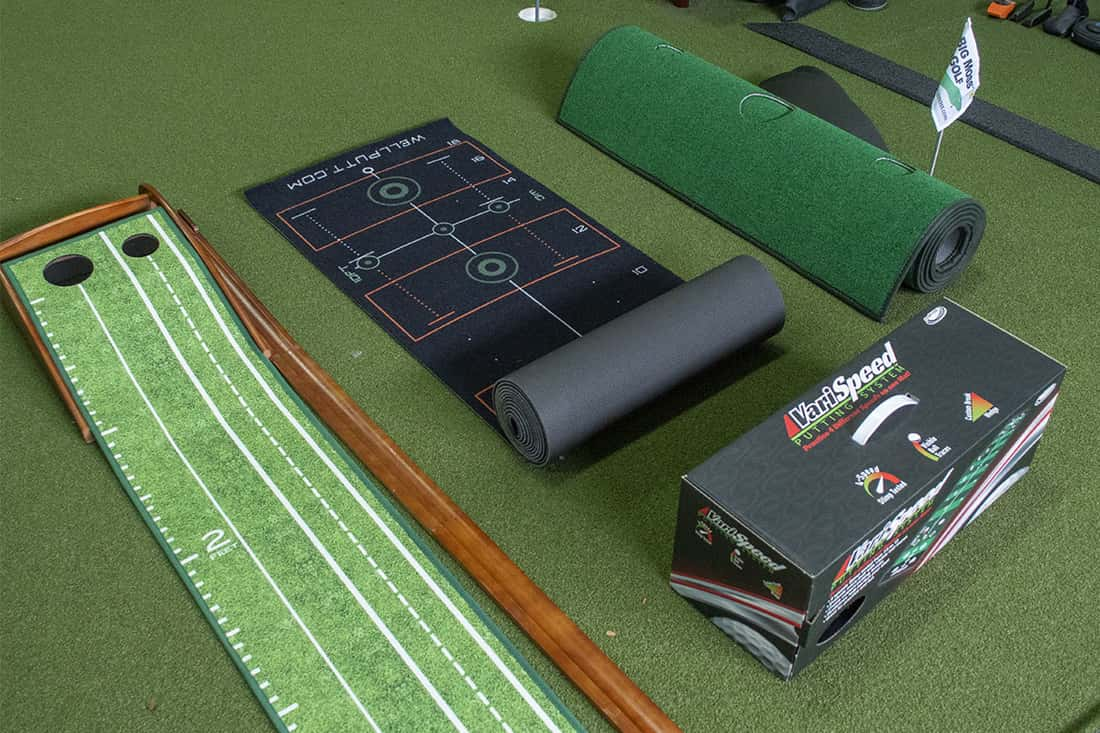Three of the best indoor putting mats next to each other