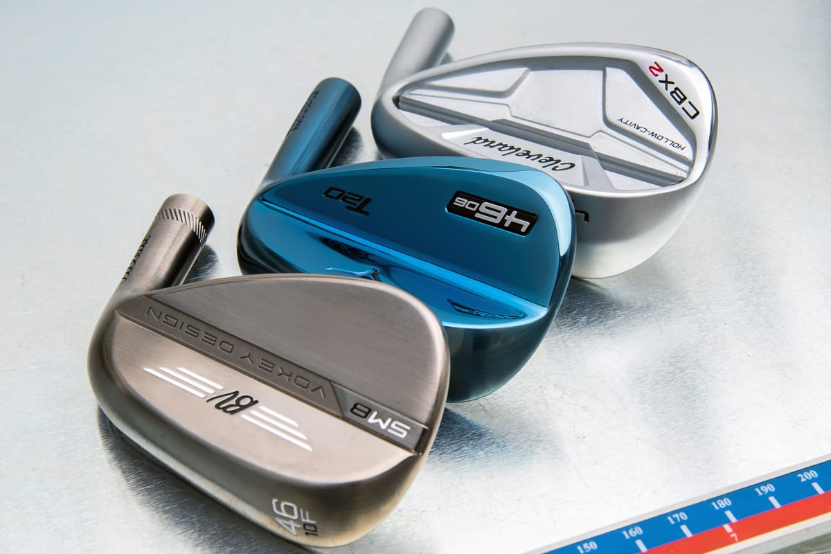 The heads of three specialty pitching wedges