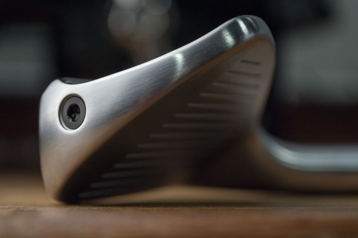 A TaylorMade P770 Iron lying on its side that has been review