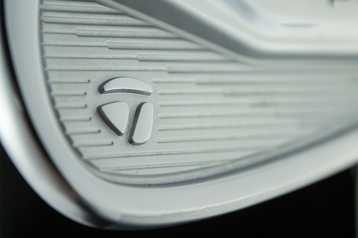 Closeup of a TaylorMade P7MC Iron ready to be reviewed