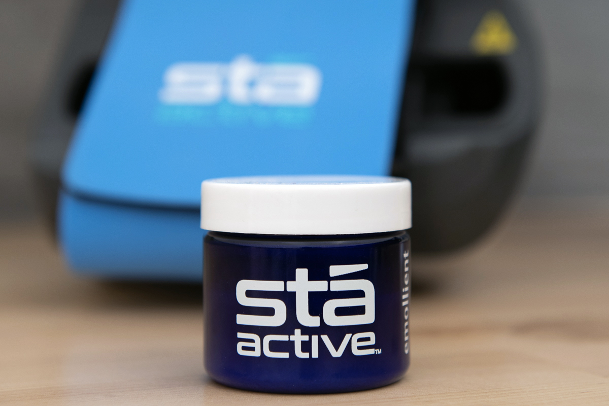a jar of emollient (lube) for the Sta Active tennis elbow treatment device