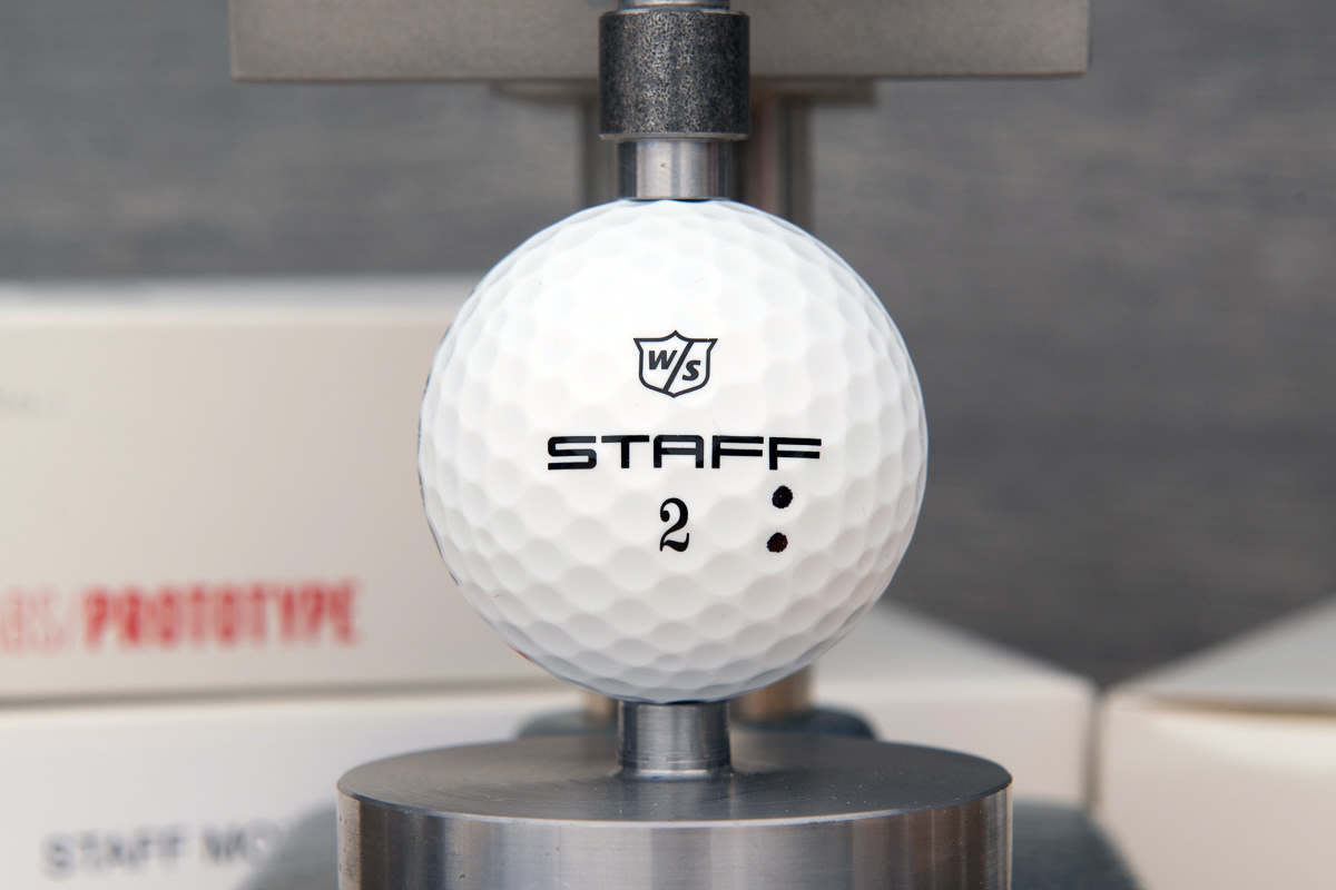 the logo and player number on the Wilson Staff Model R golf ball